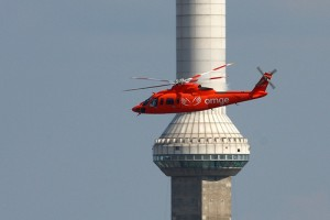 Helicopter flying over the CN Tower Skypod - the best place to see Ivan Kristoff's work