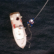 Helicopter rappelling on a boat